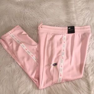 Small pink Nike sweatpants